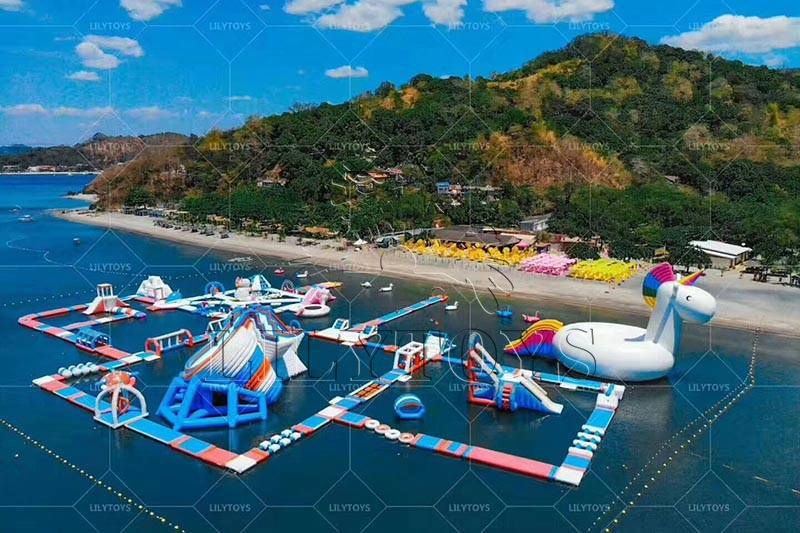 Lilytoys new design commercial large inflatable water sport floating inflatable aqua park adventure water park TUV obstacles course water slide
