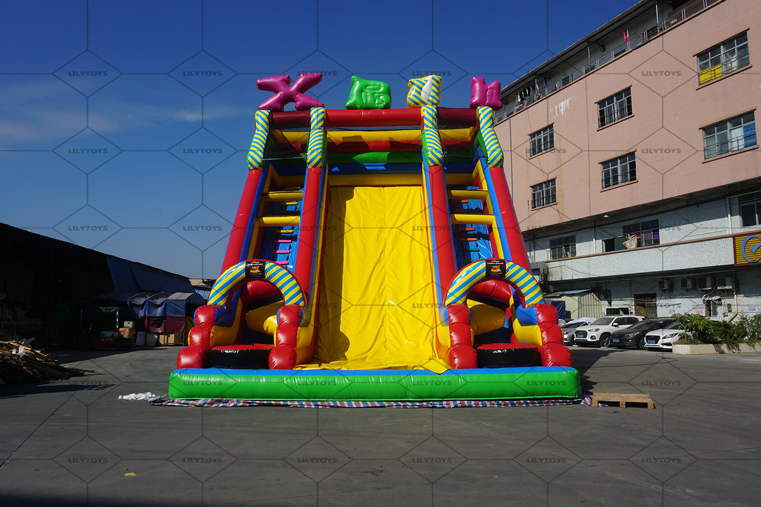 Inflatable high slide with letter
