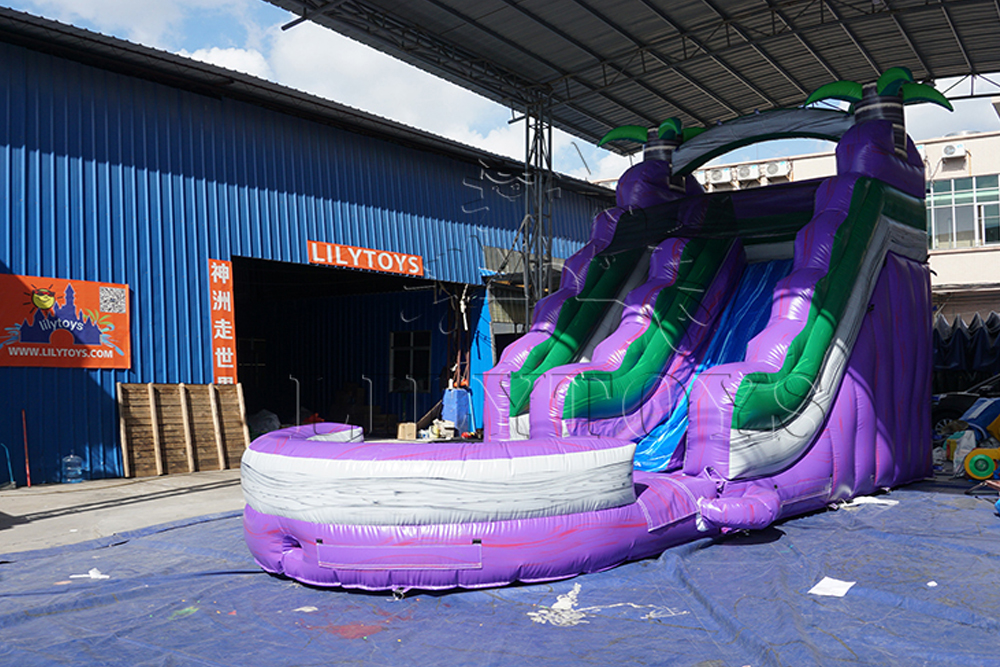 purple inflatable water slide with big pool