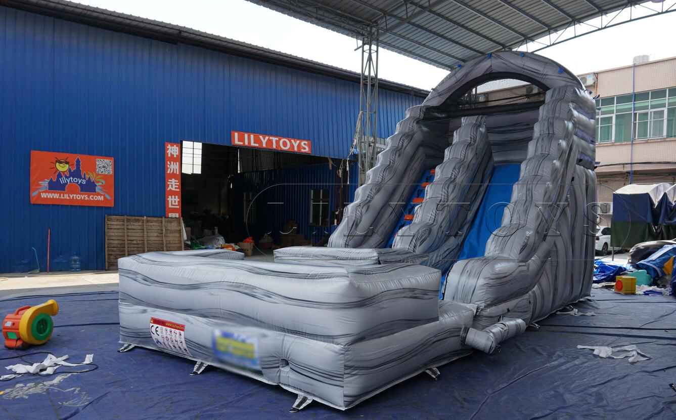 small grey inflatable water slide commercial use