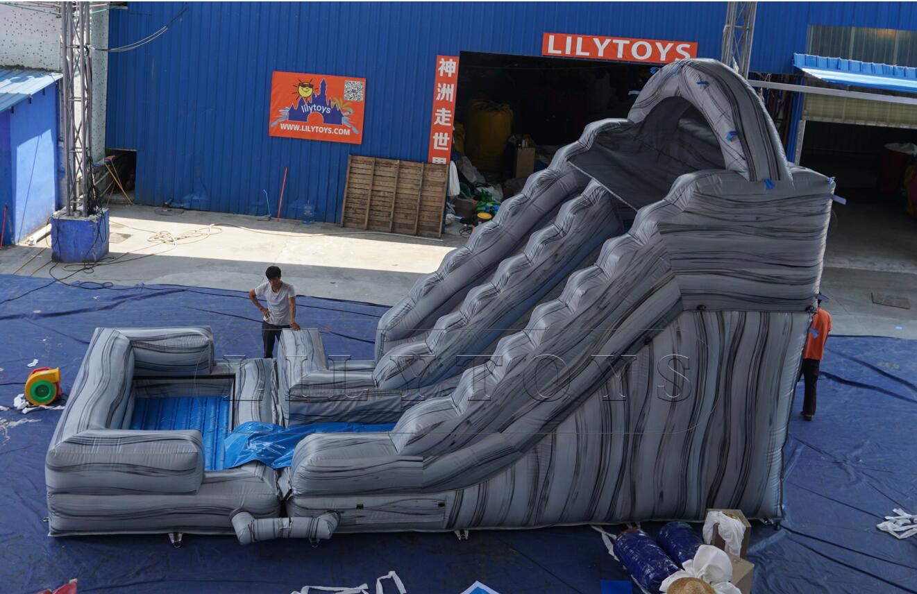 grey rock inflatable slide with pool for kids