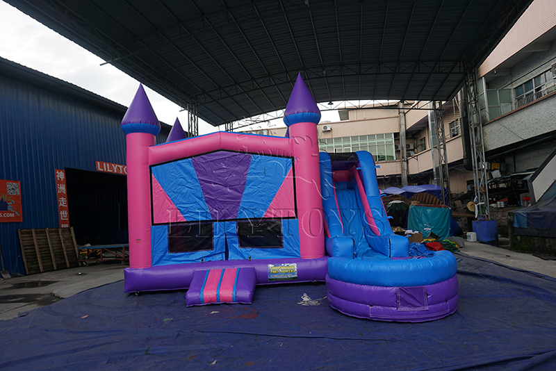Pink inflatable bounce castle with slide