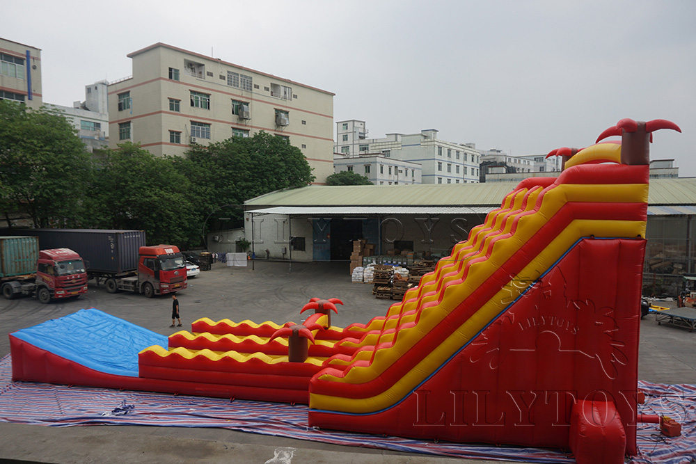 orange plam tree giant inflatable water slide with fly