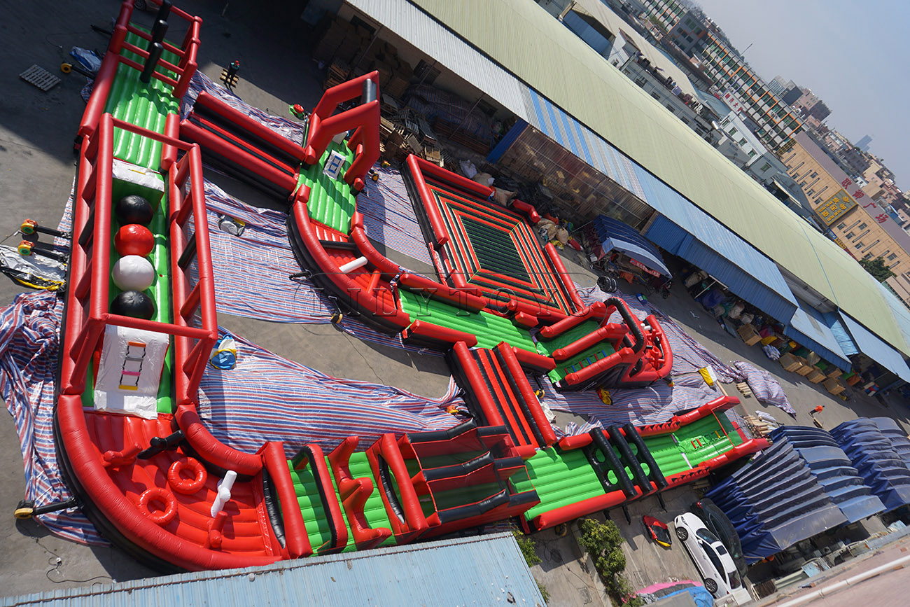 Red inflatable obstacle course