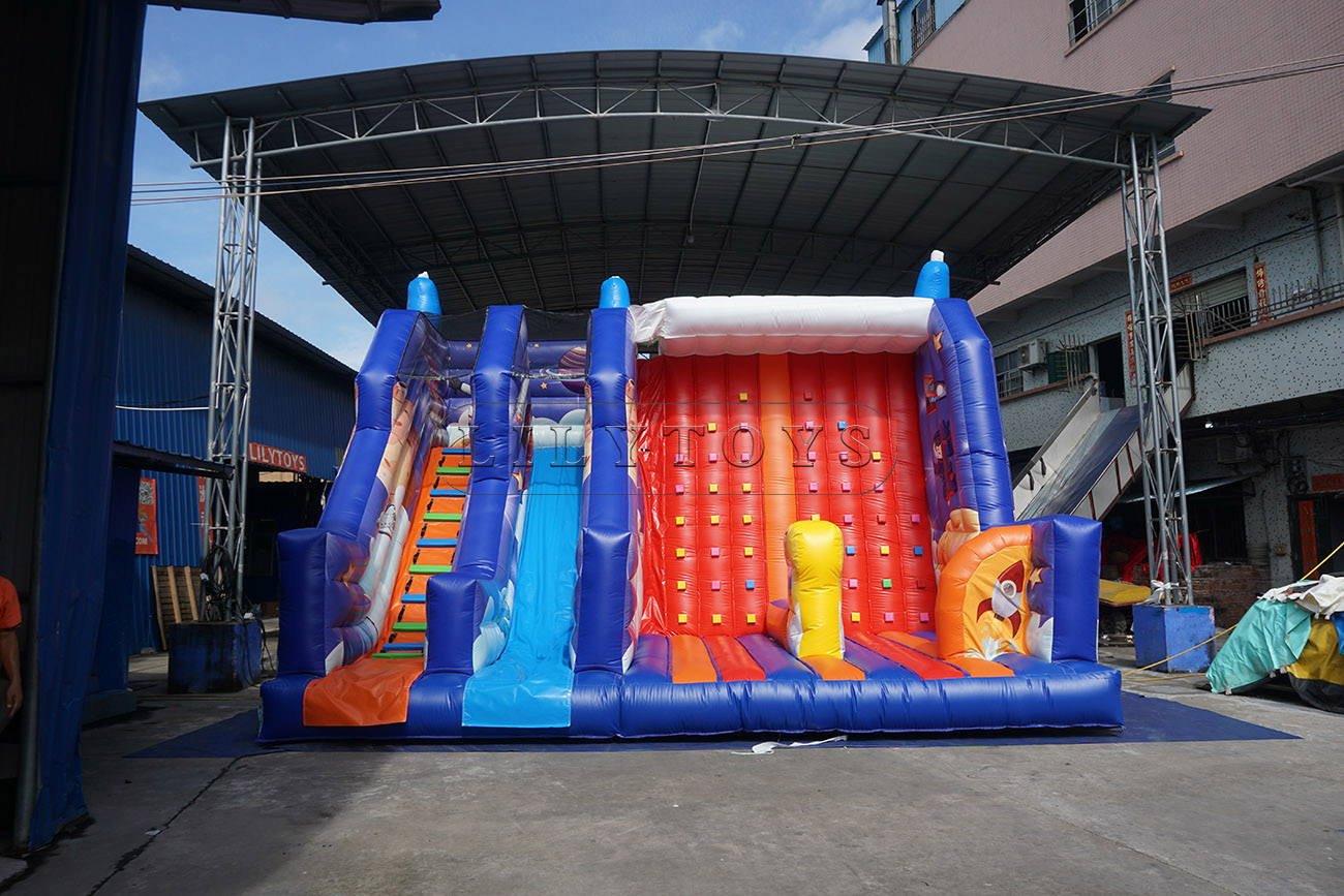 Inflatable dry slide with rock climbing