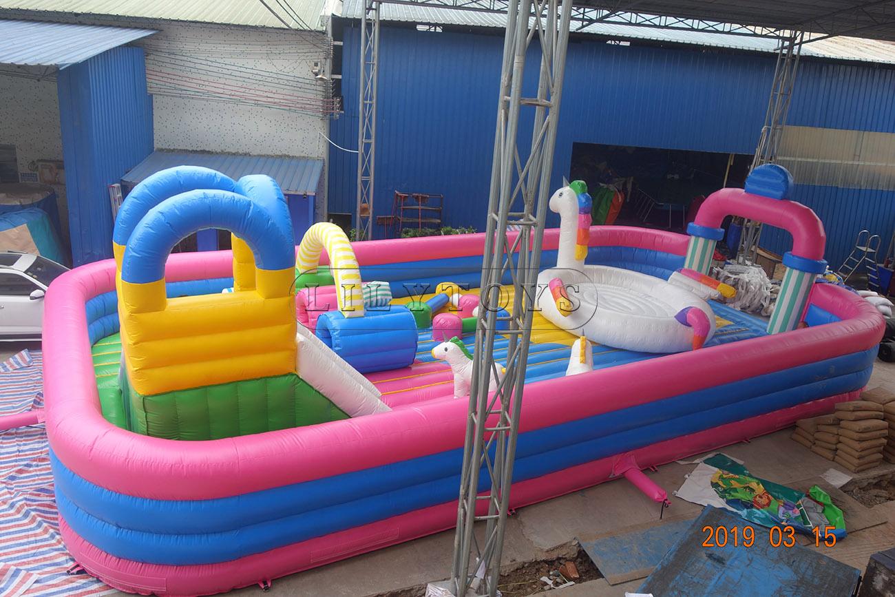 inflatable pink and blue unicorn fun city amusement park